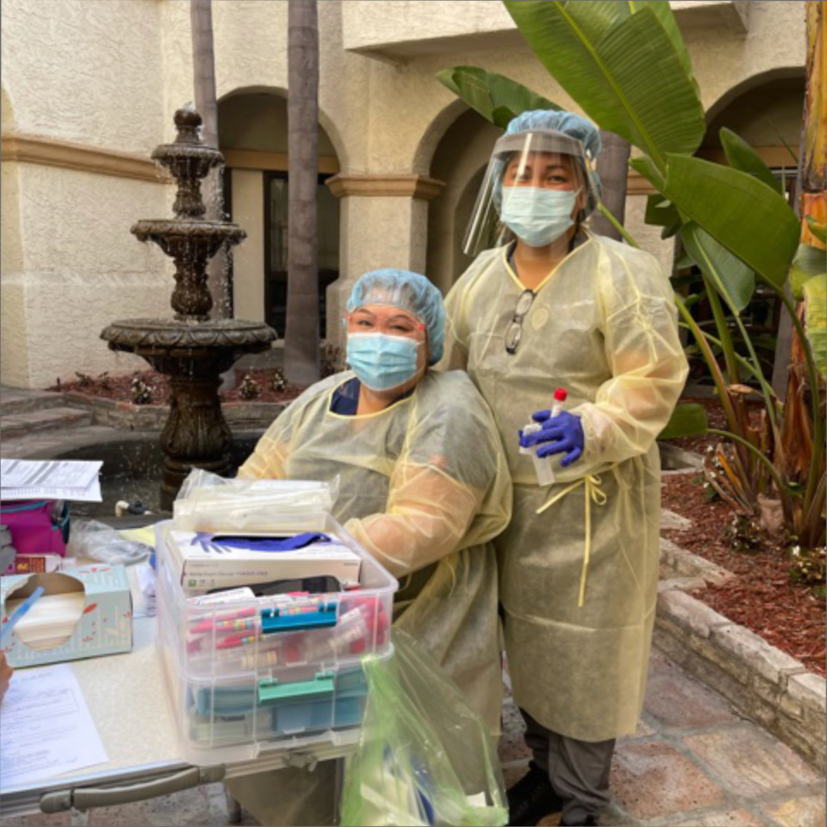 Two women in protective suit